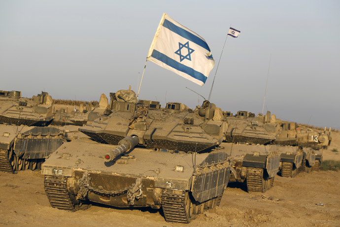 Israeli tanks are seen in a staging area near the border with the Gaza Strip August 7, 2014. (Reuters)