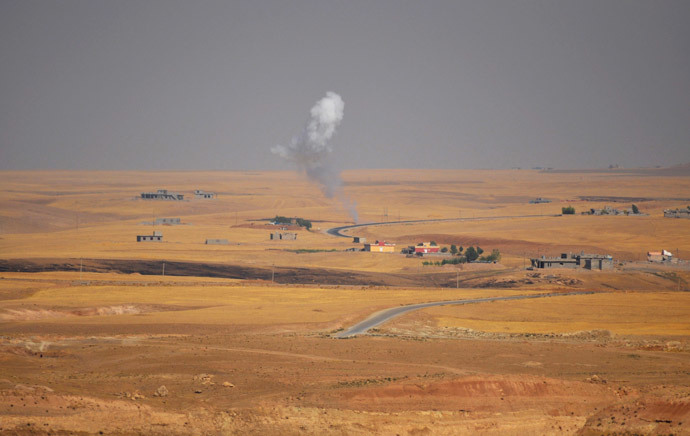 "Smoke rises during clashes between Kurdish ""peshmerga"" troops and militants of the Islamic State, formerly known as the Islamic State in Iraq and the Levant (ISIL), on the outskirts of Sinjar, west of Mosul, (Reuters / Stringer)"