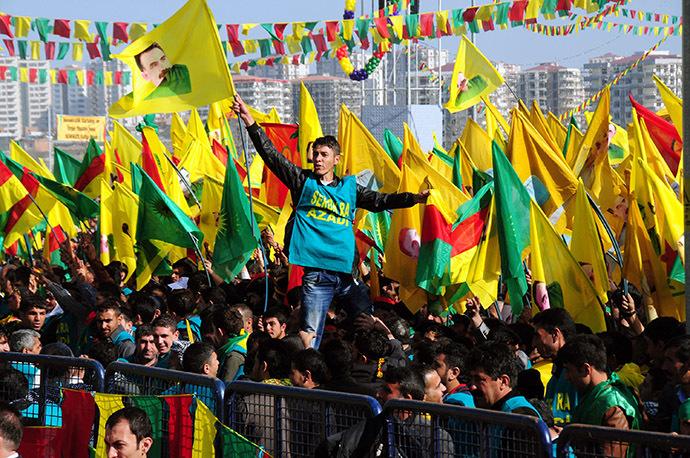 A Kurdish man waves a poster of founder of PKK (Kurdish Worker Party) Abdullah Ocalan during celebrations of Nowruz, the Persian New Year festival in Diyarbakir. (AFP Photo)