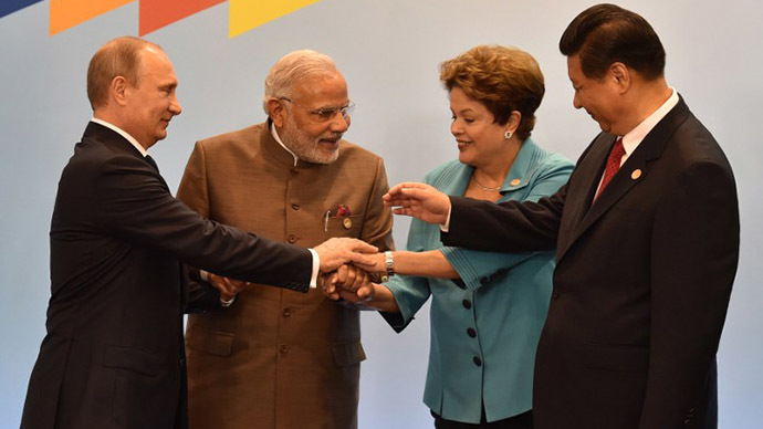 (L to R) Russia's President Vladimir Putin, India's Prime Minister Narendra Modi, Brazilian President Dilma Rousseff, China's President Xi Jinping join their hands during the official photograph of the 6th BRICS summit in Fortaleza, Brazil, on July 15, 2014. (AFP Photo / Nelson Almeida)
