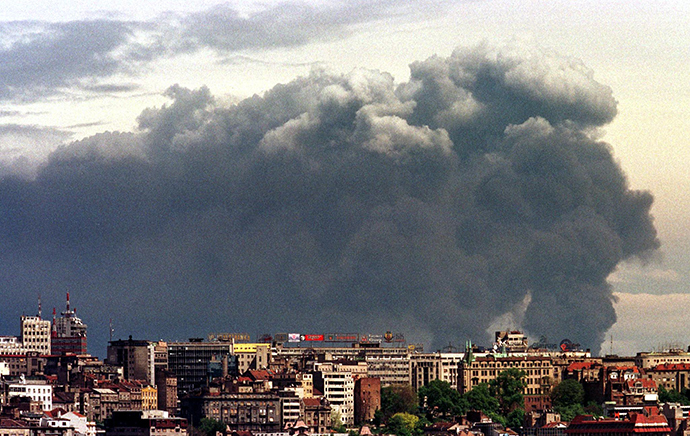 Smoke loomes over Yugoslav capital of Belgrade from Pancevo's chemical plant after NATO air strike on this April 18, 1999 file photo (Reuters)