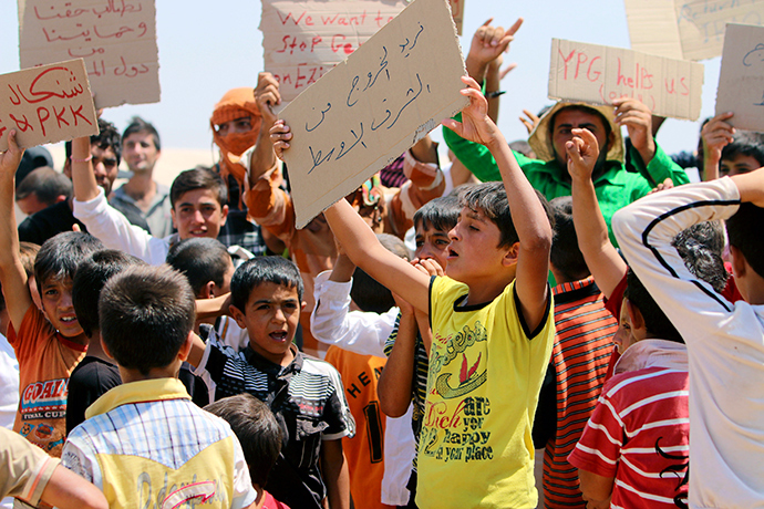 Refugees from the minority Yazidi sect, who fled the violence in the Iraqi town of Sinjar, take part in a protest to call for their evacuation from the Middle East and an end to what they say is violence against their community, at Nowruz refugee camp in Qamishli, northeastern Syria, August 17, 2014 (Reuters / Rodi Said)