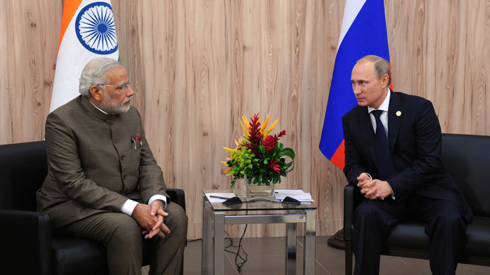 India's Prime Minister Narendra Modi (L) speaks with Russia's President Vladimir Putin during their meeting on the sidelines of the BRICS group leaders sumit in Fortaleza, Brazil, on July 16, 2014.(AFP Photo / Mikhail Klimentyev)