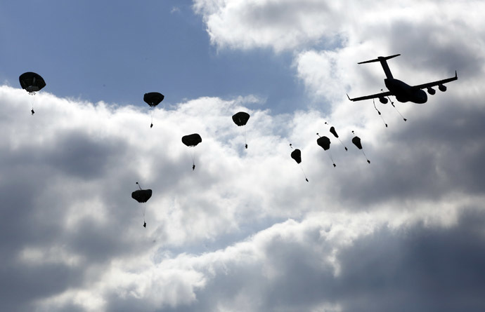 "Troops from the U.S. Army's 173rd Infantry Brigade Combat Team parachute from a Boeing C-17 Globemaster III during a NATO-led exercise ""Orzel Alert"" held together with Canada's 3rd Battalion and Princess Patricia's Light Infantry, and Poland's 6th Airborne Brigade in Bledowska Desert in Chechlo, near Olkusz, south Poland May 5, 2014. (Reuters)"