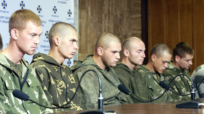 A handout photo provided on August 28, 2014 by the Unian Agency shows Russian paratroopers captured by Ukrainian forces near the village of Dzerkalne, Donetsk region, some 20 to 30 kilometres from the Russian border, attending a press conference the day before in Kiev. (AFP/UNIAN)