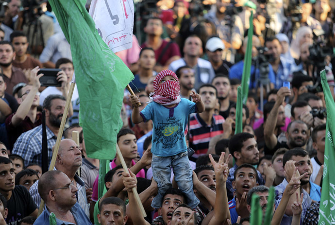 Palestinians Hamas supporters celebrate with people what they said was a victory over Israel, in Gaza City August 27, 2014. (Reuters)