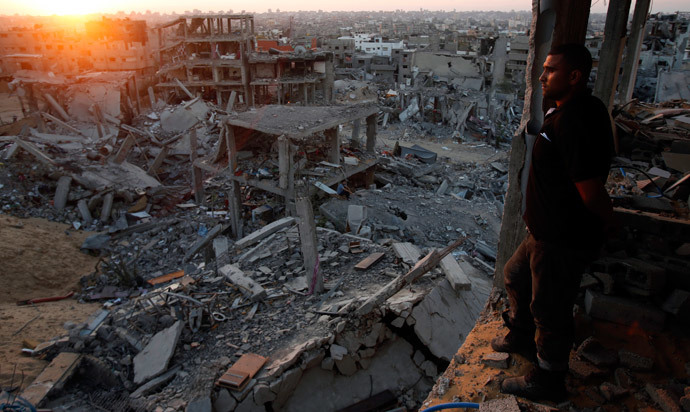 A Palestinian man looks out of his heavily damaged house at neighbouring houses which witnesses said were destroyed during the Israeli offensive, in the east of Gaza City September 3, 2014.(Reuters / Suhaib Salem )