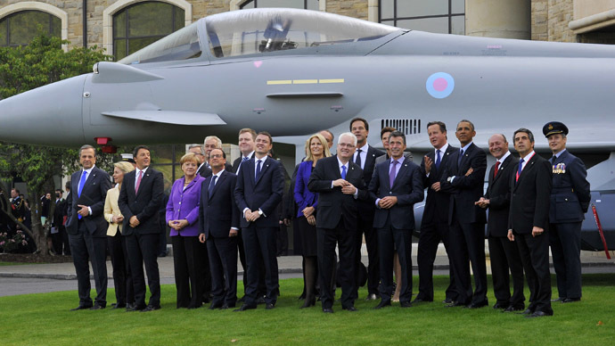 NATO leaders watch a fly-past by the Red Arrows during the NATO summit at the Celtic Manor resort, near Newport, in Wales September 5, 2014. (Reuters/Rebecca Naden)