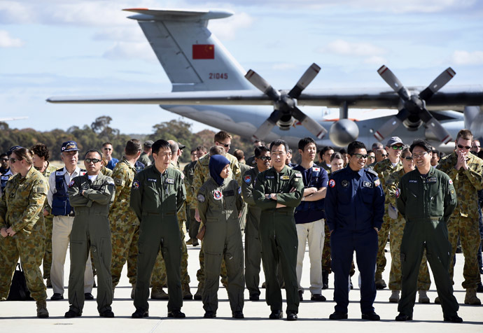 International and Australian aircrews involved in the search for missing Malaysia Airlines plane MH370 prepare for an official photograph as they stand on the tarmac at the Royal Australian Air Force (RAAF) Pierce Base in Bullsbrook, near Perth, April 29, 2014. (Reuters)
