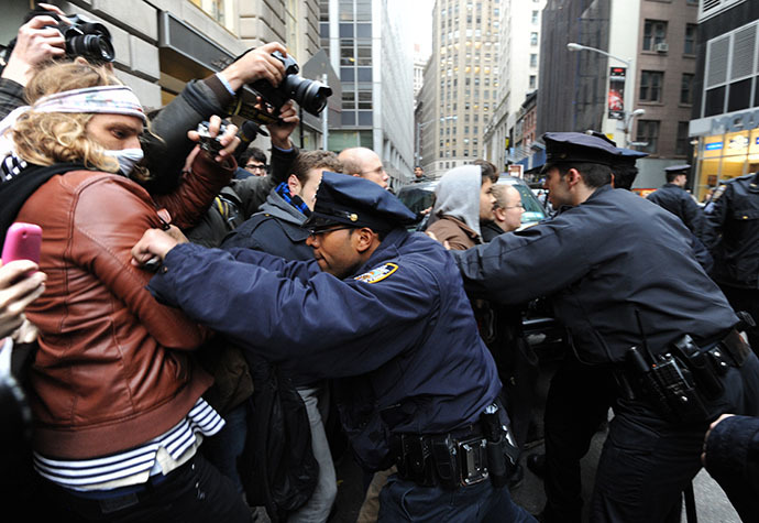 New York Police Department officers push back people as demonstrators with 'Occupy Wall Street' mark the two month anniversary of the protest November 17, 2011 in New York. (AFP Photo / Stan Honda)