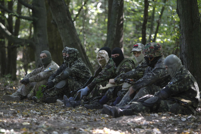 Pro-Ukrainian fighters take part in guerilla tactics training in a forest outside Kiev September 11, 2014. (Reuters)