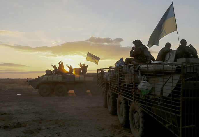 Ukrainian paratroopers ride on armoured vehicles near Debaltseve September 13, 2014. (Reuters/Gleb Garanich)