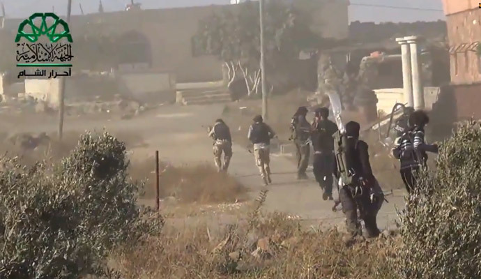 Opposition fighters advancing as they capture a Syrian government forces position in the village of Khan Arnabeh, near the eastern border crossing of Quneitra with Israel in the Golan Heights. (AFP Photo / HO / Ahrar Al-Sham)