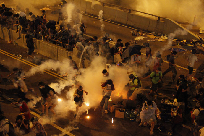 Riot police fire teargas to disperse protesters after thousands of demonstrators blocked the main street to the financial Central district outside the government headquarters in Hong Kong September 29, 2014. (Reuters/Stringer)