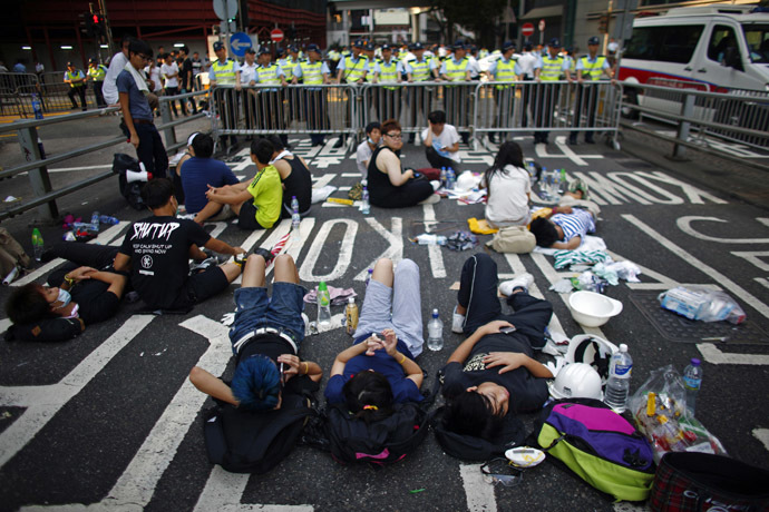 Protesters block a street near government headquarters in Hong Kong September 30, 2014. (Reuters/Carlos Barria)