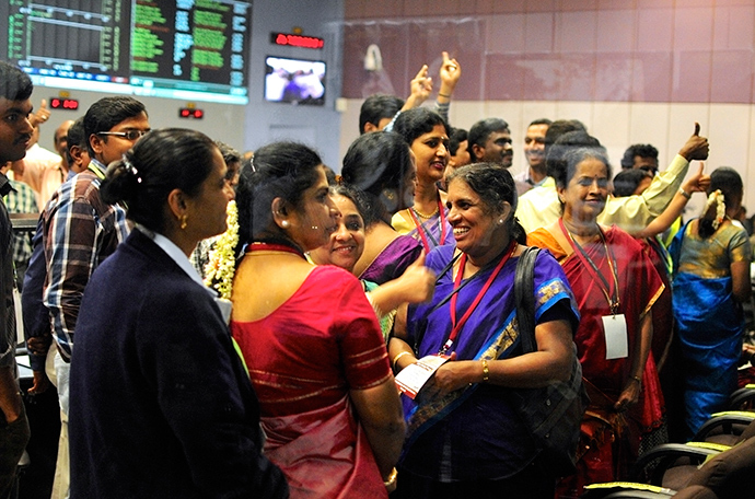 Indian Space Research Organization (ISRO) scientists and engineers cheer after India's Mars orbiter successfully entered the red planet's orbit, at their Spacecraft Control Center, in this photo taken through a glass panel, in the southern Indian city of Bangalore September 24, 2014 (Reuters / Abhishek N. Chinnappa)