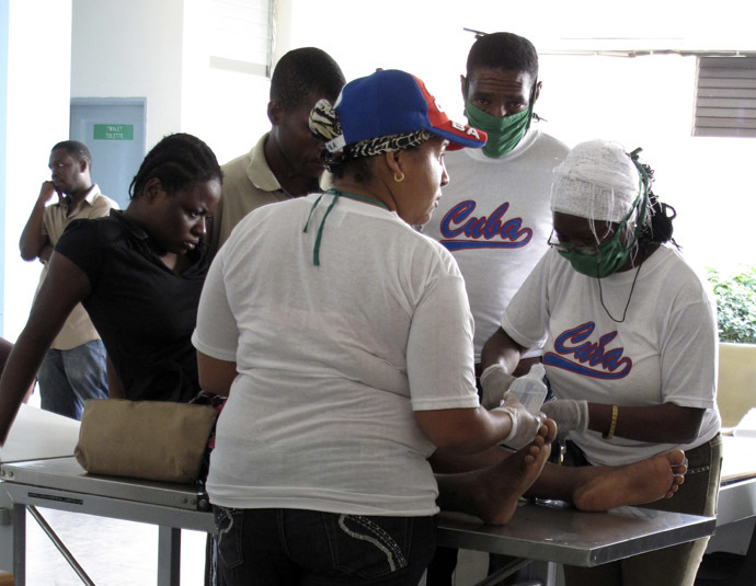 Cuban medical personnel treat an earthquake victim in the Hospital Universitaire de la Paix in central Port-au-Prince January 18, 2010. (Reuters)
