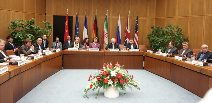 (L-R), EU Deputy Secretary General Helga Schmid, Vice President of the European Commission Catherine Margaret Ashton, Iranian Foreign Minister Javad Mohammad Zarif, and Iranian ambassador to Austria Hassan Tajik attend a meeting at the socalled EU 5+1 talks with Iran at the UN headquarters in Vienna, on July 3, 2014. (AFP Photo / Joe Klamar)