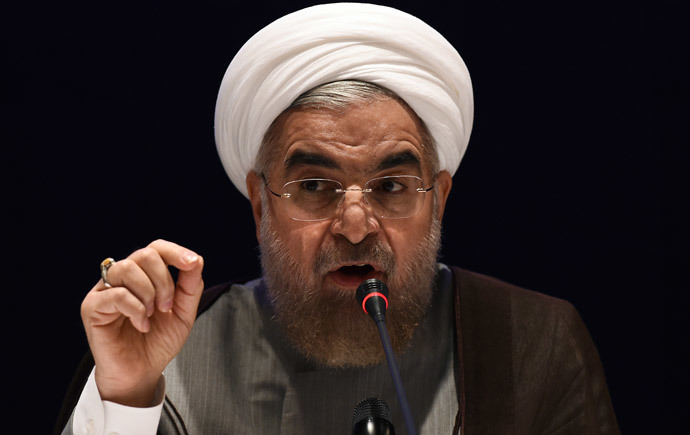 Iranian President Hassan Rouhani answers a question during press conference in New York on September 26, 2014. (AFP Photo / Jewel Samad)