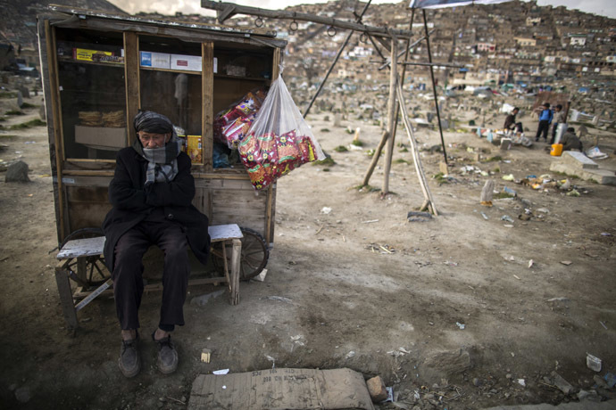 A street vendor waits for customers near a cemetery in Kabul. (Reuters/Zohra Bensemra)