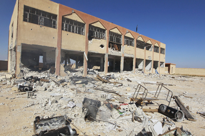 A damaged school building, which was used by Kurdish fighters as a base, is seen in al-Aziza village in the countryside of the Syrian Kurdish town of Kobani, after the Islamic State fighters took control of the area October 7, 2014. (Reuters/Stringer)