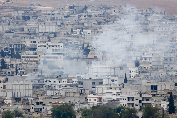 Smoke rises from the Syrian town of Kobani, seen from near the Mursitpinar border crossing on the Turkish-Syrian border in the southeastern town of Suruc in Sanliurfa province, October 16, 2014. (Reuters/Kai Pfaffenbach)