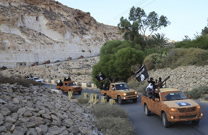 An armed motorcade belonging to members of Derna's Islamic Youth Council, consisting of former members of militias from the town of Derna, drive along a road in Derna, eastern Libya October 3, 2014. (Reuters/Stringer)