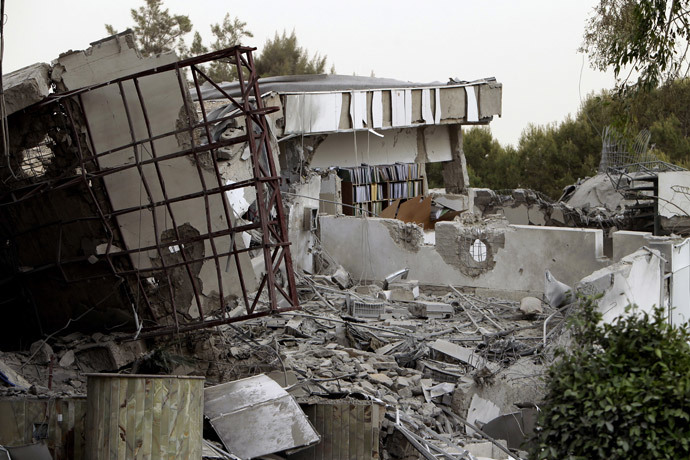 A picture shows the damaged offices of Libyan leader Moamer Kadhafi after they were hit by NATO bombs in the Bab Al-Aziziya district of Tripoli on April 25, 2011 (AFP Photo / Joseph Eid)