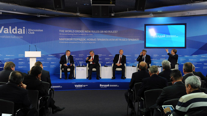 24 October 2014. Russian President Vladimir Putin (far center) at the wrap-up session of the 11th Meeting of the Valdai Discussion Club in Sochi.(RIA Novosti / Michael Klimentyev)