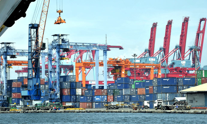 A crane stacks shipping containers at the international container port in Tanjung Priok, North Jakarta (AFP Photo / Bay Ismoyo)