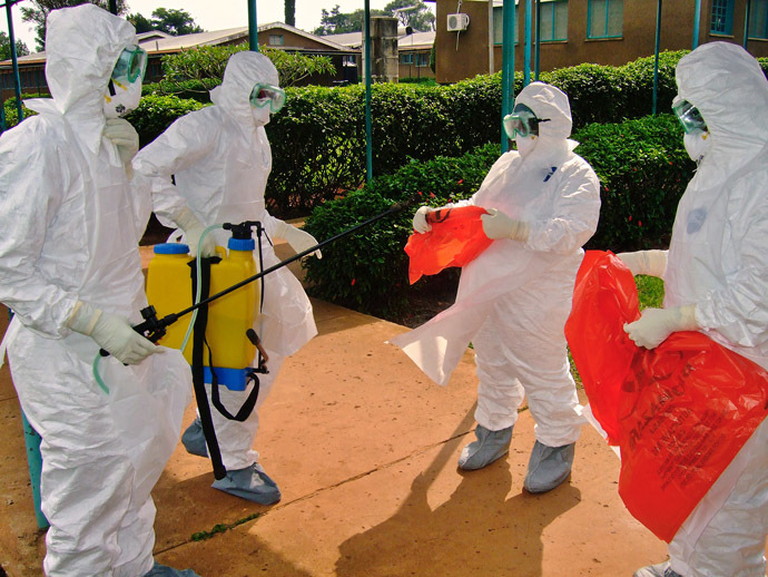 (FILES) -- A picture taken on July 28, 2012 shows officials from the World Health Organization wearing protective gear against the Ebola virus as they prepare to enter Kagadi Hospital in Uganda's western Kibale district, around 200 kilometres (125 miles) from Kampala. (AFP Photo)