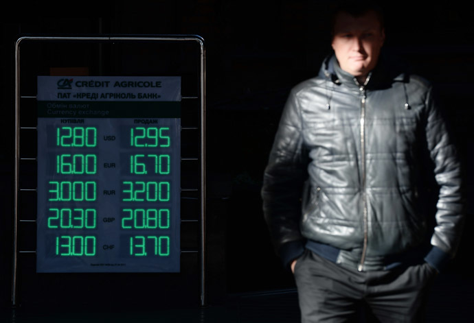 A sign showing currency exchange rates on a street in Kiev. (RIA Novosti/Maksim Blinov)