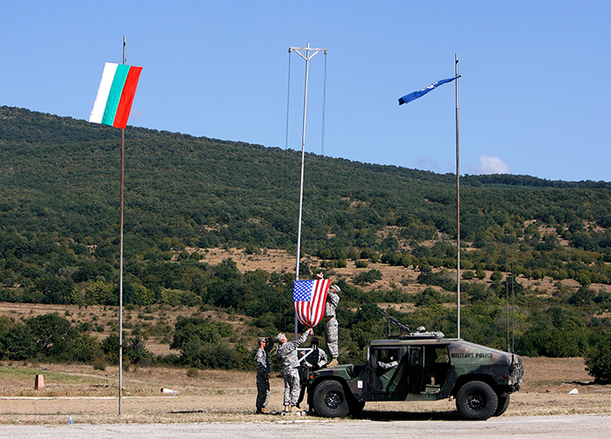"U.S. soldiers raise the U.S. flag near the Bulgarian (L) and the NATO flags at the opening ceremony of ""Bulgaria Panther"" military exercise at Novo Selo military base near the town of Sliven, some 350 km (217 miles) east of Sofia (Reuters / Stoyan Nenov)"