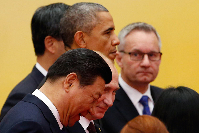 China's President Xi Jinping (front), Russia's President Vladimir Putin (2nd row), and U.S. President Barack Obama (3rd row) walk as they take part in an Asia-Pacific Economic Cooperation (APEC) family photo inside the International Convention Center at Yanqi Lake in Beijing, November 11, 2014 (Reuters / Kim Kyung-Hoon)