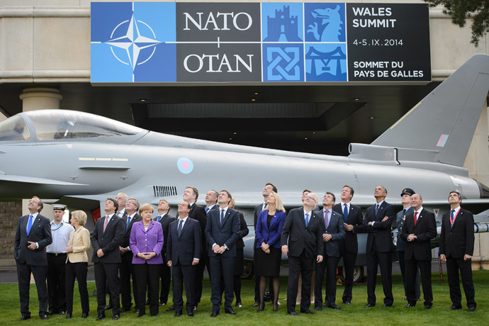 NATO Leaders watch a flypast of military aircraft on the second day of the NATO 2014 Summit at the Celtic Manor Resort in Newport, South Wales, on September 5, 2014. (AFP Photo/Leon Neal)