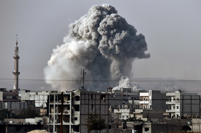 Smoke rises from the the Syrian town of Ain al-Arab, known as Kobane by the Kurds, after a strike from the US-led coalition as it seen from the Turkish-Syrian border in the southeastern village of Mursitpinar, Sanliurfa province, on October 14, 2014. (AFP Photo/Aris Messinis)