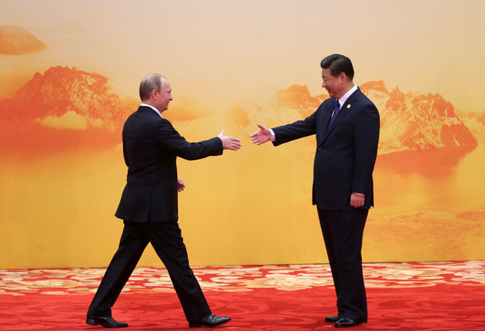 Russian President Vladimir Putin, left, and Chinese President Xi Jinping (RIA Novosti)