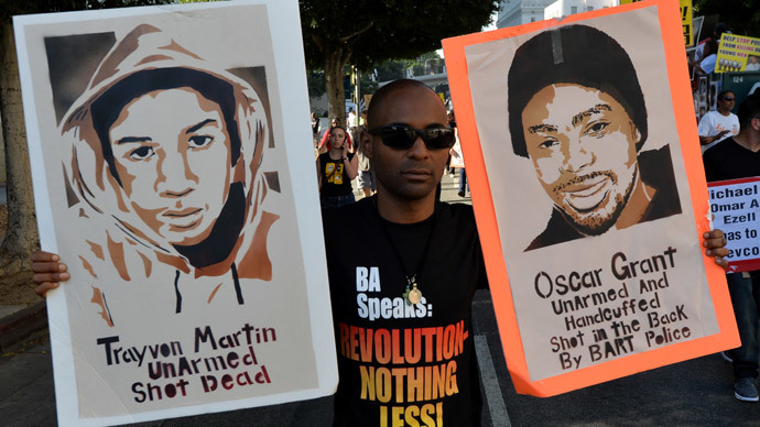 Demonstrators protest outside of the Los Angeles Police Department (LAPD) headquarters during their annual 'National Day of Protest to Stop Police Brutality', in Los Angeles, California on October 22, 2014.(AFP Photo / Mark Ralston)