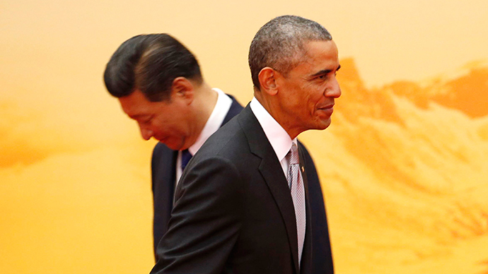 U.S. President Barack Obama (front) walks past his Chinese counterpart Xi Jinping during a welcoming ceremony of Asia Pacific Economic Cooperation (APEC) forum, inside the International Convention Center at Yanqi Lake, in Beijing, November 11, 2014 (Reuters / Kim Kyung-Hoon)