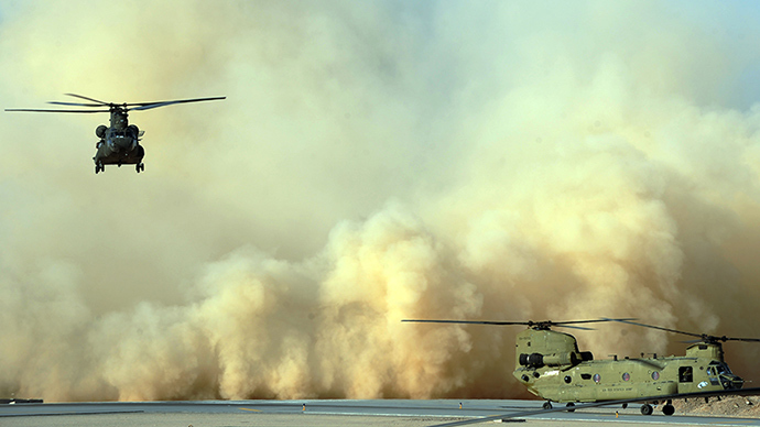 Two US army Chinook helicopters land at Kandahar airfield in southern Afghanistan on March 30, 2011 (AFP Photo)