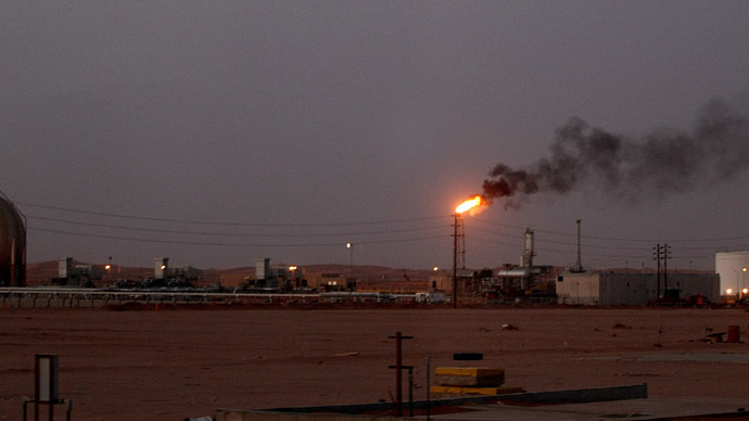 "A flame from a Saudi Aramco (the national oil company) oil installation known as ""Pump 3"" burns brightly during sunset in the Saudi Arabian desert near the oil-rich area Al-Khurais. (AFP Photo/Marwan Naamani)"