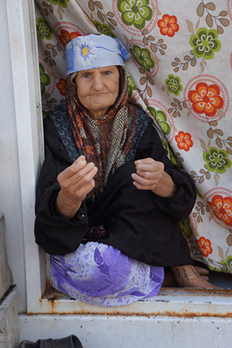 A Syrian elderly woman doesn't hope to make it back home (Image by Nadezhda Kevorkova)