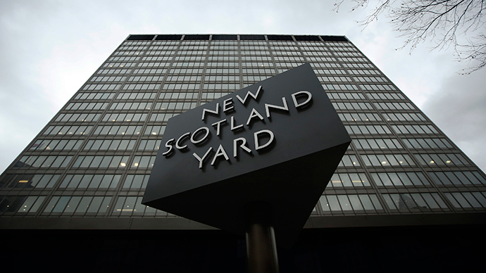 A sign is seen outside New Scotland Yard in central London (Reuters / Luke MacGregor)