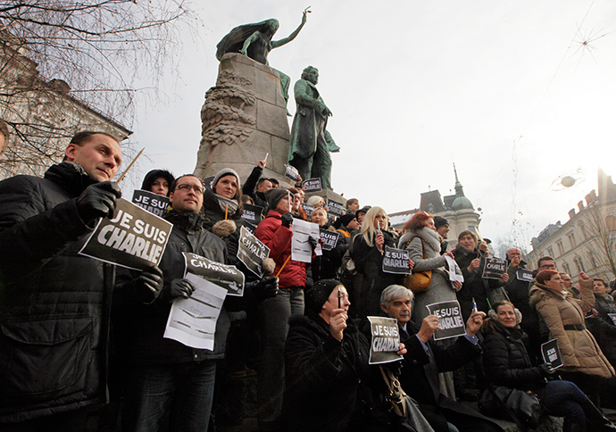 "Journalists and other people hold placards reading ""I am Charlie"" during a minute of silence for the victims of Wednesday's shooting at the Paris offices of weekly newspaper Charlie Hebdo in Ljubljana January 8, 2015 (Reuters / Srdjan Zivulovic)"