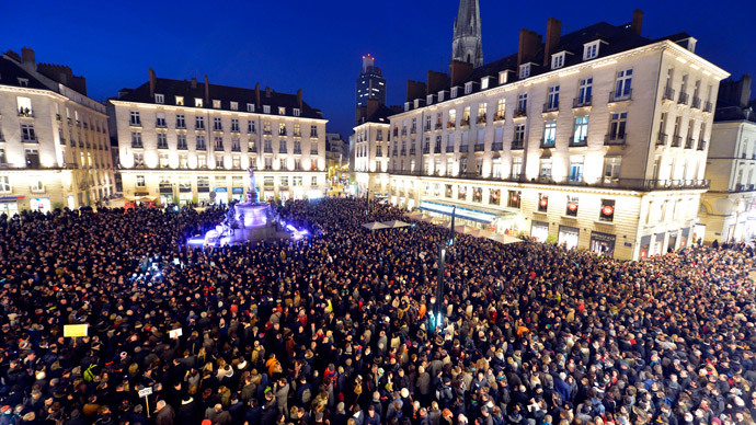 People gather at the Place Royale in Nantes on January 7, 2015.(AFP Photo / Georges Gobet)