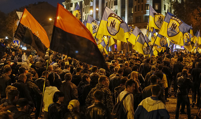 Activists of the Ukrainian nationalist parties take part in a procession to mark the Day of Ukrainian Cossacks to honour the role of the movement in Ukraine's history, in Kiev. (Reuters/Gleb Garanich)