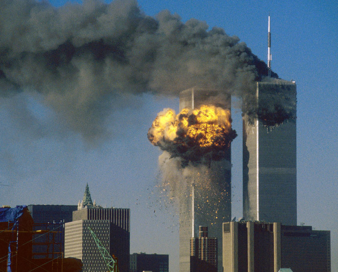 The World Trade Center south tower (L) burst into flames after being struck by hijacked United Airlines Flight 175 as the north tower burns following an earlier attack by a hijacked airliner in New York City September 11, 2001. (Reuters / Sean Adair)