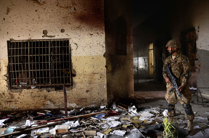 In this photograph taken on December 18, 2014, a Pakistani army soldier stands guard at the site of a militant attack on an army-run school in Peshawar. (AFP Photo / A Majeed / Files)