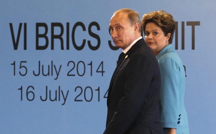 Brazil's President Dilma Rousseff (R) walks with Russian President Vladimir Putin. (Reuters/Nacho Doce)