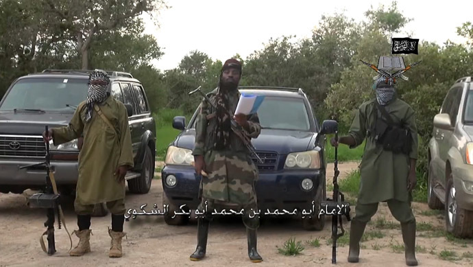 A screengrab taken on August 24, 2014 from a video released by the Nigerian Islamist extremist group Boko Haram and obtained by AFP shows the leader of the Nigerian Islamist extremist group Boko Haram, Abubakar Shekau (C), delivering a speech at an undisclosed location. (AFP Photo/Boko Haram)
